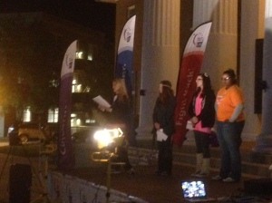 Ole Miss students dedicate the lighting of the luminaria at Relay for Life. PHOTO BY: Drake Davis