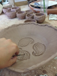 Jenny Crowson of Spirit Song Studio creating a design in a handmade bowl