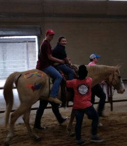 Volunteer Ann Rodgers helping Ammon Lunceford ride Horse Slim at Horses for Handicap at Jackson, Mississippi Horse Arena. Disabled children and adult came from all over the state to ride horses and enjoy the festivities. Photographed by Richard Williams 4/20/2015